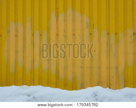 Sheet Metal Wall Old Yellow Background Texture With Screws And Bottom Band White Snow.