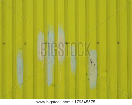 Yellow With White Shaped Strip Metal Wall Background Texture With Screws In The Middle Of The Rough.
