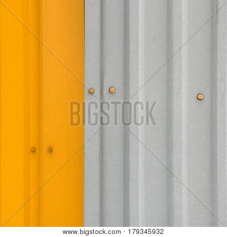 Metal Two Colors A Fragment Of A Wall: Left Yellow, Gray And Right, On The Gray Background Attached