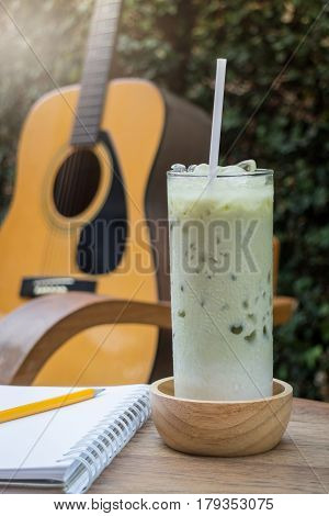 Matcha Tea With Milk On Creative Work Table stock photo