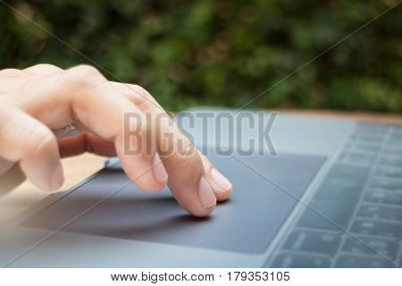 Woman Hand Using Laptop Touchpad stock photo
