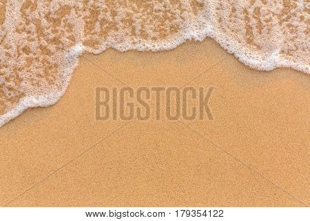 Wave on the sand beach background