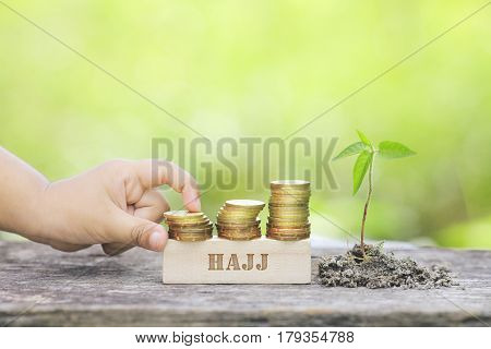 Hajj Word Golden Coin Stacked With Wooden Bar.