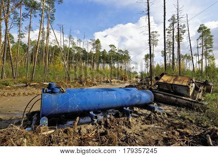 Laying of pipeline in the Siberian taiga, refueling tank equipment