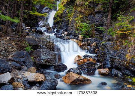 Long exposure of stream waterfalls along hike to  Mirador Torres in Torres del Paine National Park in Chile