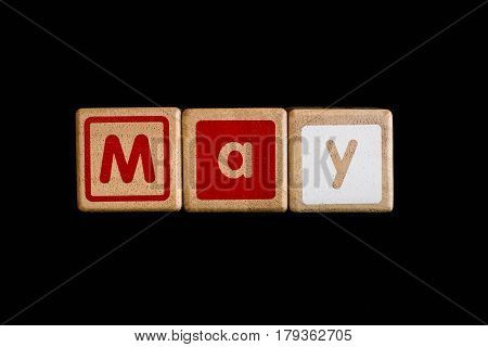 may on wood Cubic on black background