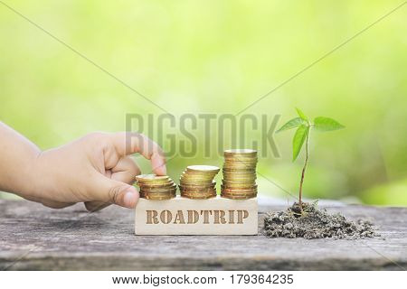 Roadtrip Word Golden Coin Stacked With Wooden Bar.