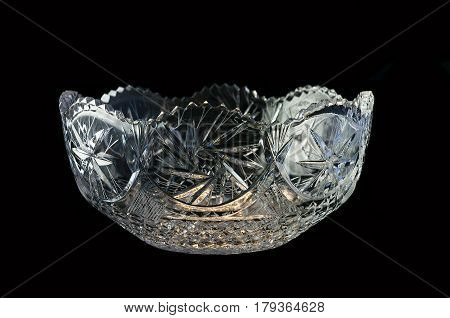 vase from crystal with stars with blue illumination on a black background
