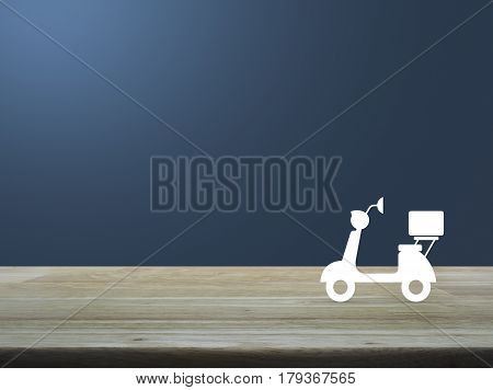 Motor bike icon on wooden table over light blue gradient background Business delivery service concept