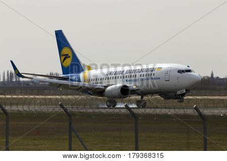 Borispol, Ukraine - March 25, 2017: Ukraine International Airlines Boeing 737-500 aircraft landing on the runway to Borispol International Airport on March 25, 2017. Editorial use only
