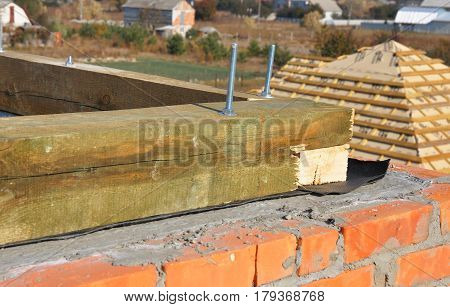 Close up on building roof construction with waterproofing membrane on brick wall. Roofing Construction. Wooden Roof Frame House Construction.