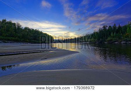Sunset evening. Beach taiga river Big Yugan
