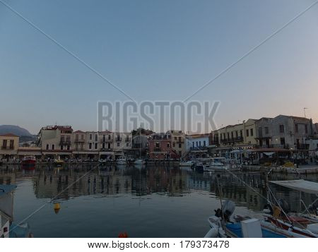 Rethymno, Greece - August  6, 2016:  Venetian Harbour At The Evening.