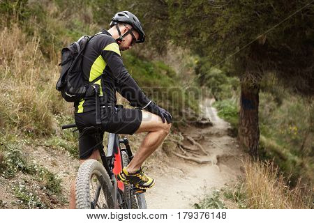 People, Sports, Extreme And Travel Concept. Young Caucasian Male Rider In Cycling Clothes Having A F