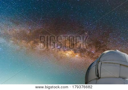 observatory with milky way galaxy long exposure photograph with grain.Image contain certain grain or noise and soft focus. color tone effect astronomy concept.