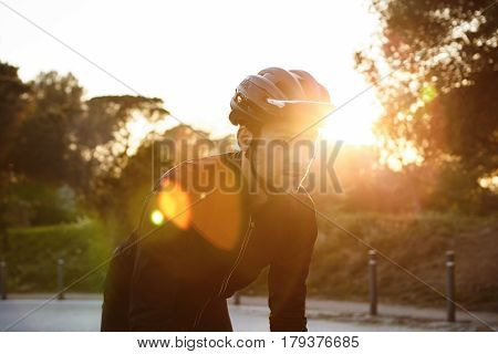 Handsome Young Professional Rider Dressed In Cycling Clothing And Protective Helmet Feeling Free And
