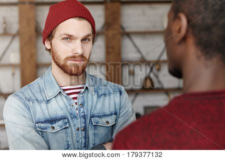 Interracial Friendship And Partnership Concept. Two Best Friends Meeting At Cafe, Discussing Plans A