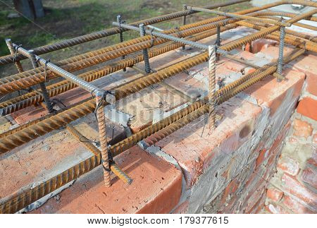Rebar steel bars reinforcement concrete bars with wire rod. Brickwork with Iron Bars for House Construction Building Brick House Wall.