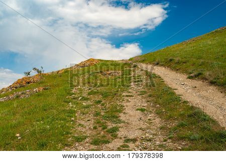 Empty hiking path to uplands in spring mountains
