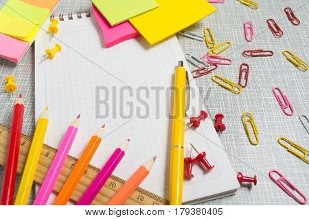Stationary in pink and yellow color with copy space
