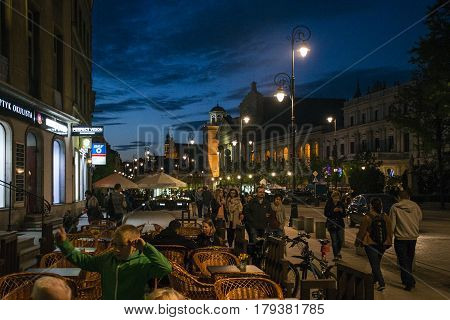 Poland Warsaw - 09.05.2015 - Night Panorama peoplae sitting by the street Building Old Town
