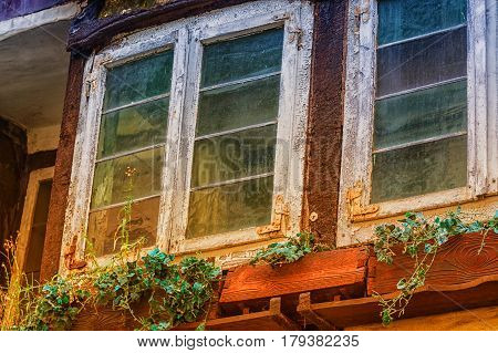 Rustic weathered old window at an old building.