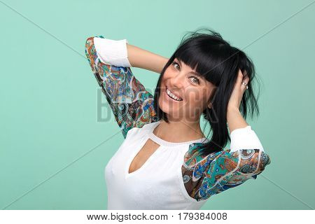 portarit of beautiful coquette young woman, isolated on green background