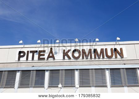 Pitea Sweden - July 24 2016: The Pitea municipal city hall building exterior with sign.
