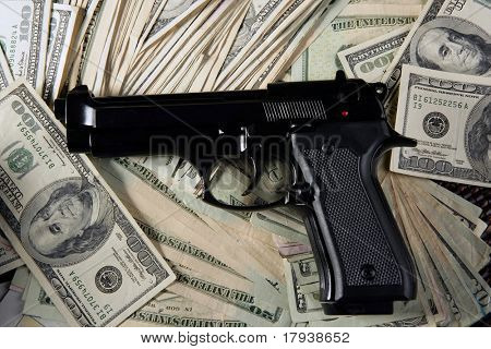 Dollar notes and gun, black pistol, mafia inspiration