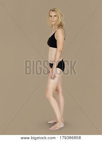 Caucasian Blonde Female Model On Brown Background