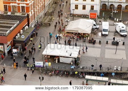 Stockhiolm Sweden - September 30 2015: Aerial photo of the market square Sodermalmstorg with people in motion and the entrance to Slussen metro station.