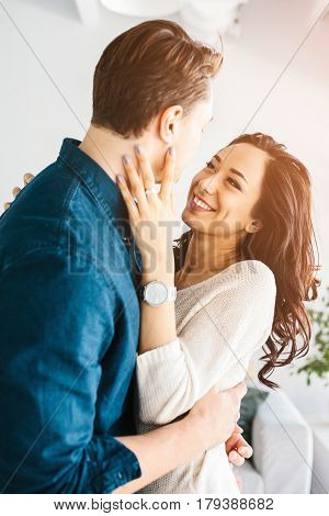 Beautiful young woman hugging with a man. Care, reliability, love and close relationships between people.