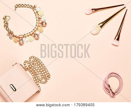 Fashion lady accessories set. Falt Lay. Stylish handbag. Make-Up brushes. Jewelry. Women accessories. Trendy fashion design