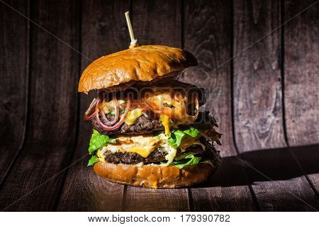Double Burger On The Board On Wooden Background