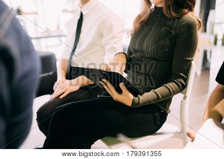 Close Up Of Young Woman Make Notice In Notebook At Meeting Of Teambuilding Work Or Presentation In O