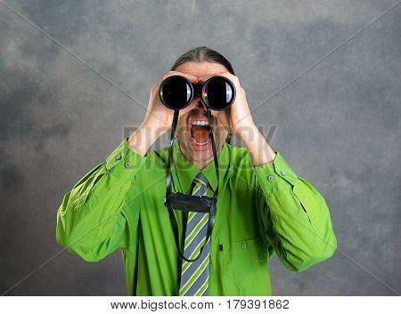 Man In Green Shirt And Necktie Looking Through A Binoculars