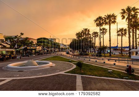 Kos island, Dodecanese, Greece - May 14, 2016: the promenade of Kos town during sunset
