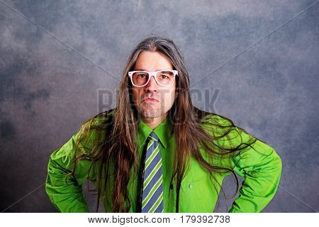 Long Haired, Angry Man In Green Shirt Pink Glasses