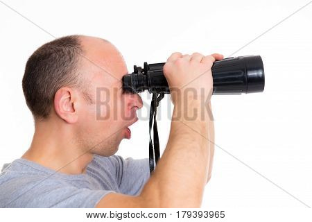 Man In Gray Shirt Looking  Through A Binoculars