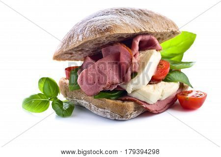Ciabatta With Ham , Mozzarella, Tomato And Basil Isolated On White