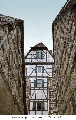 Narrow street with the old half-timbered house of wooden frame and white filling. Weil der Stadt, Baden-Wuerttemberg, Germany.