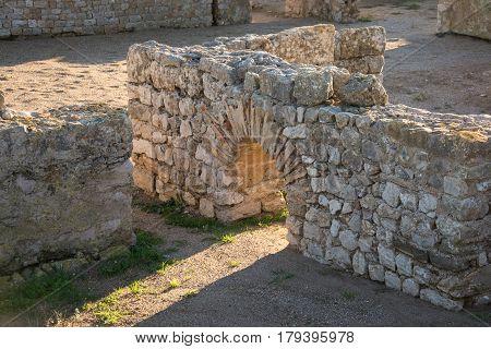 arch and walls from Greco roman ruins of Emporda, Costa Brava, Catalonia, Spain