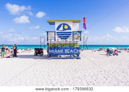 MIAMI USA - JANUARY 01 2017: Summer scene with a typical colorful lifeguard house in Miami Beach Florida with blue sky and ocean in the background