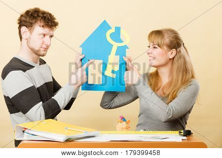 Young Couple With Different Opinion About House.