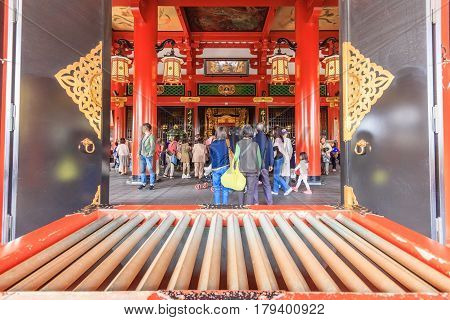 TOKYO JAPAN - APRIL 14 2014: Crowded people at Buddhist Temple Sensoji on April 14 2014 in Tokyo Japan. The Sensoji temple in Asakusa area is the oldest temple in Tokyo.