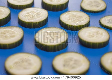 The Pattern Of Cucumber On Blue Background,
