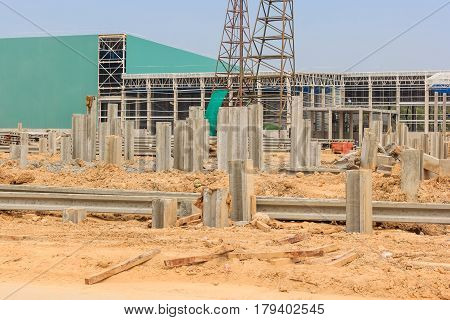 Reinforced concrete piles of the new factory on new construction site.