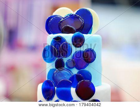 Delicious blue glass wedding cake close up