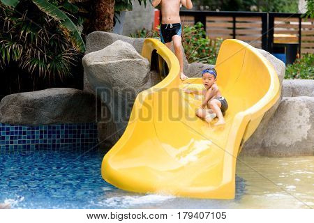 Young Boy Play Water Slide