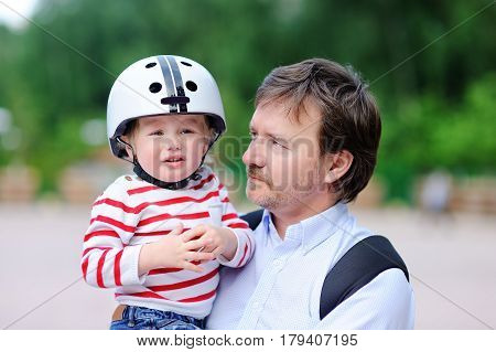 Crying Toddler Boy And His Father Outdoors